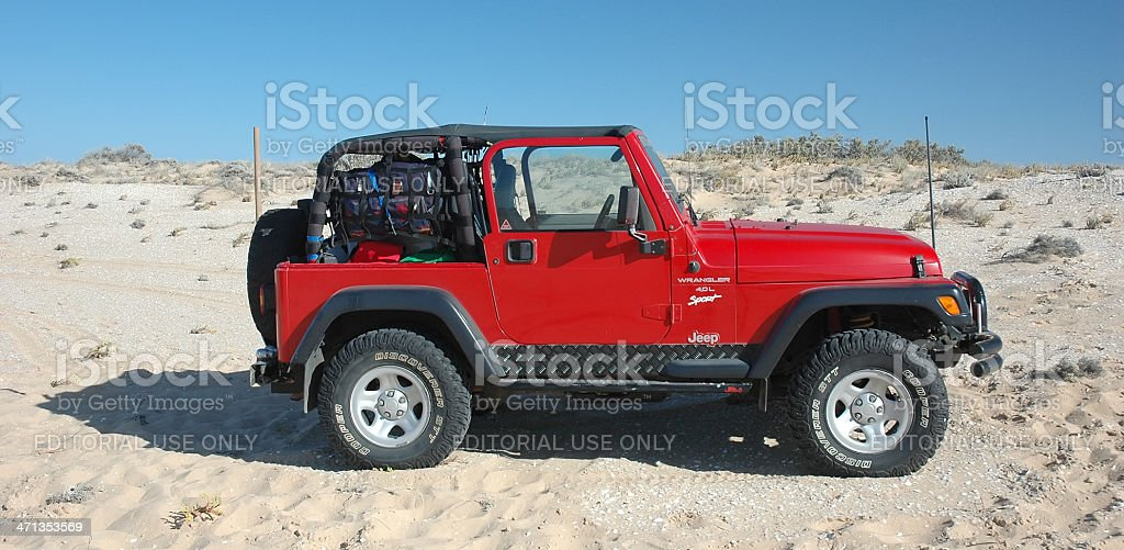 Red TJ Jeep Wrangler driving near the Coorong, South Australia stock photo