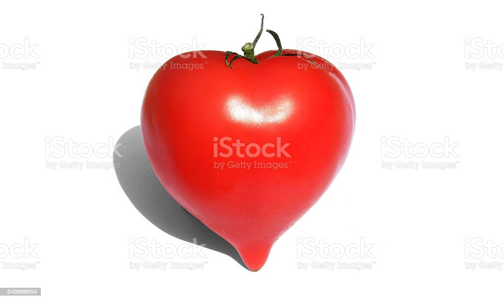 Red Tomato in the form of heart. stock photo