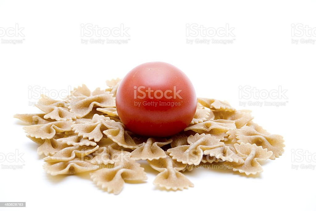 Red tomato with noodles stock photo