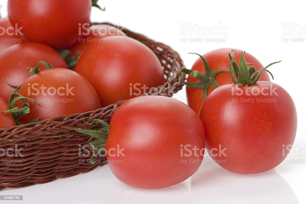 red tomatoes in basket stock photo