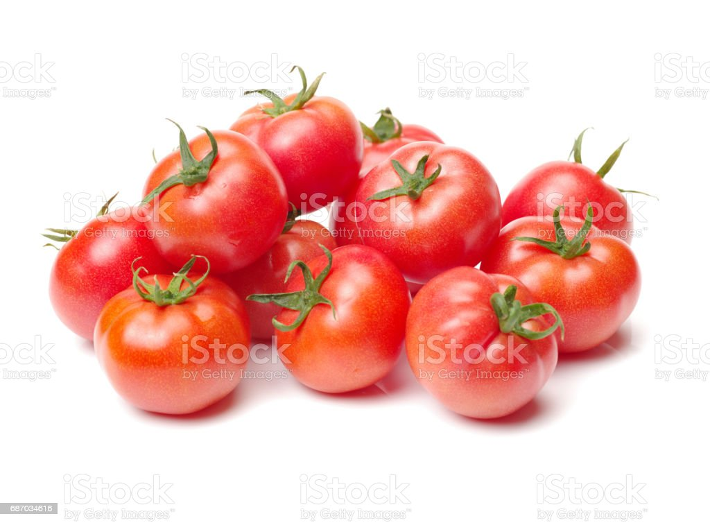 Red tomatoes  on a white background stock photo