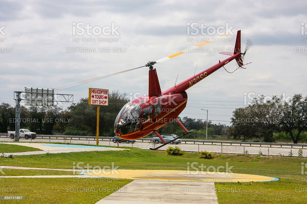 Red tourist helicopter takes off  for sightseeing journey in Orlando stock photo