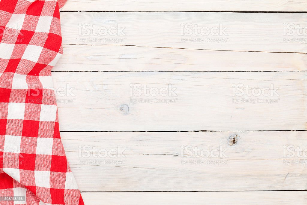 Red towel over wooden kitchen table stock photo