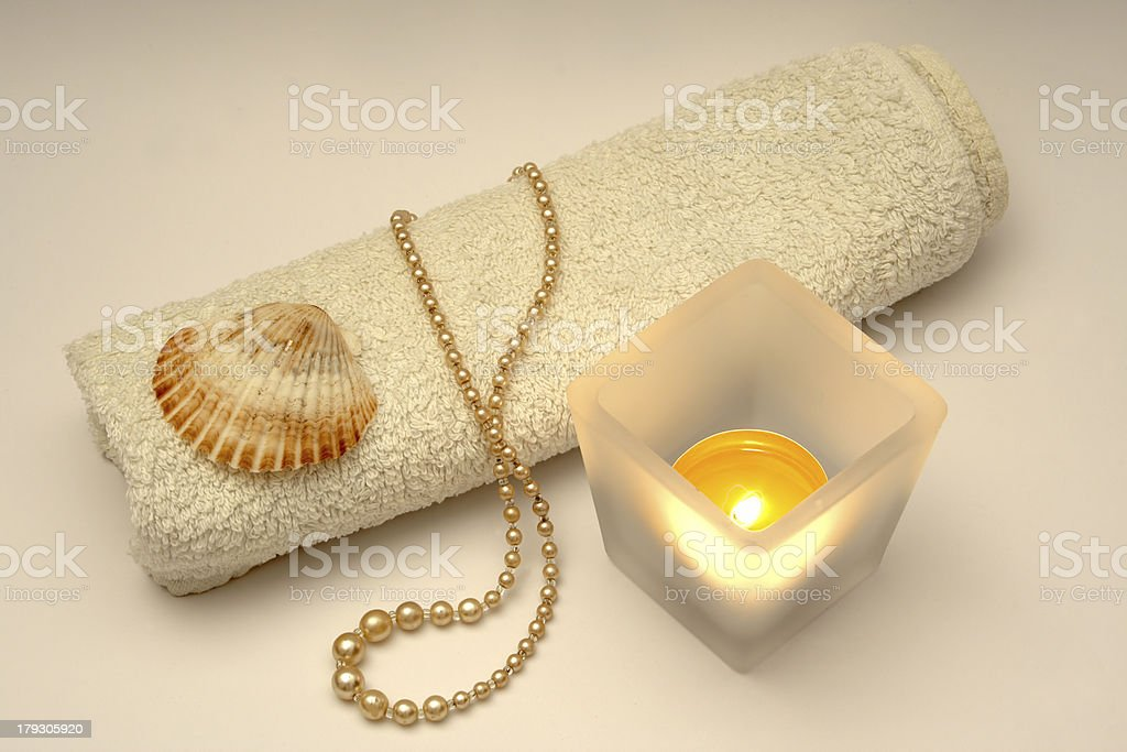 red towel, shell, candle, and perl necklace royalty-free stock photo