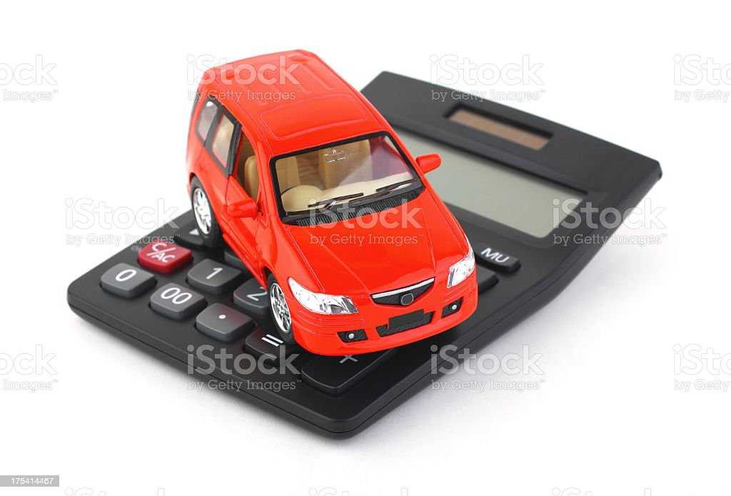 Red toy car on top of black calculator royalty-free stock photo
