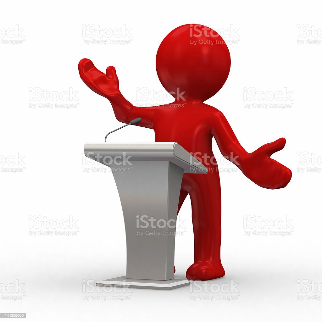Red toy figure standing at white podium as if lecturing royalty-free stock photo