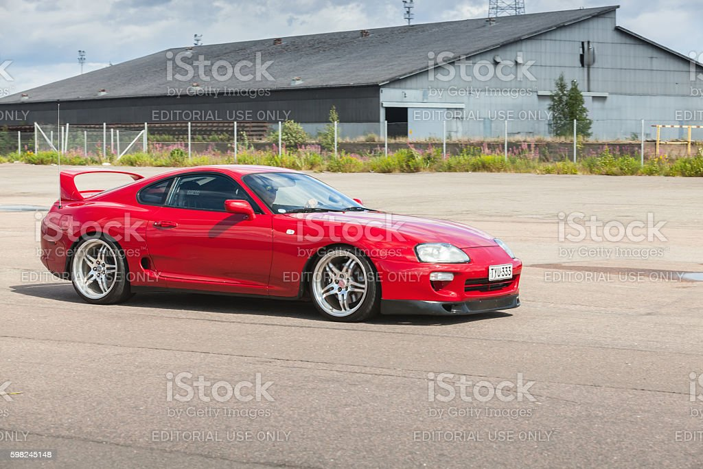 Red Toyota Supra A80 stock photo