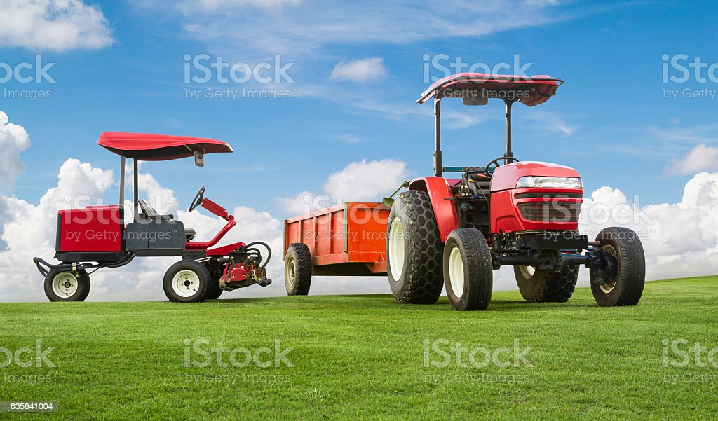 Red tractor and mowers with trailer stock photo