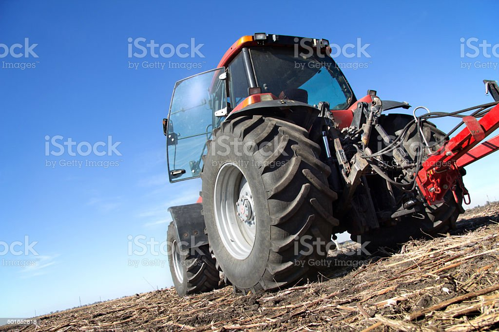 Red tractor with plow stock photo