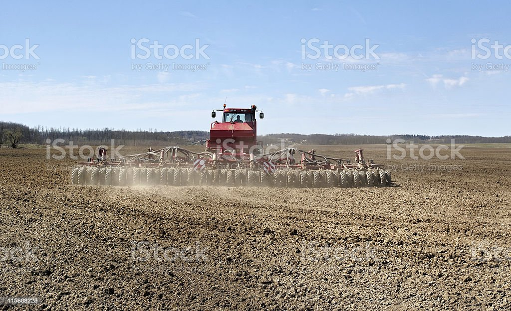 Red tractor working. royalty-free stock photo