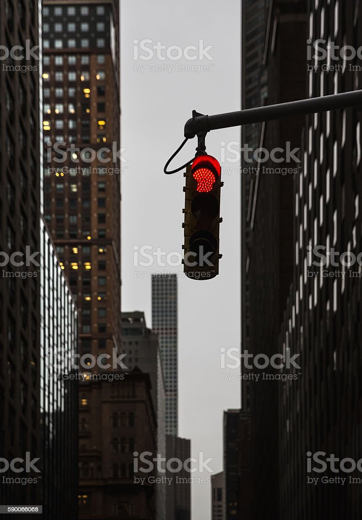 Red traffic light at the crossroads in NYC stock photo