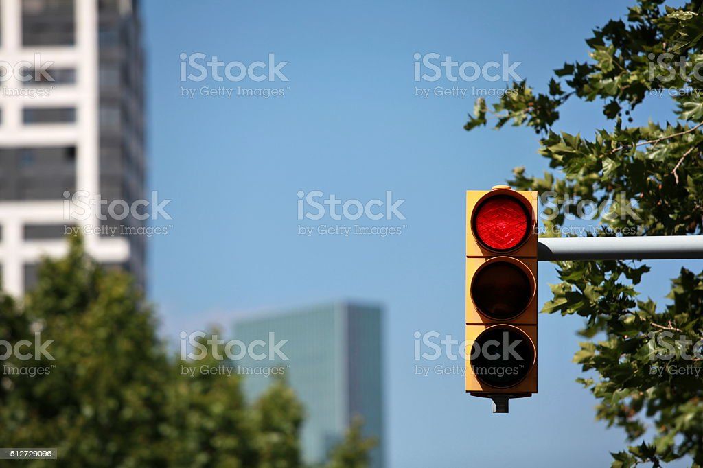red traffic light in the city stock photo