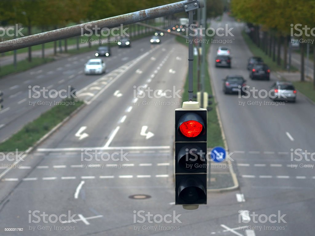 red traffic light in the city traffic stock photo
