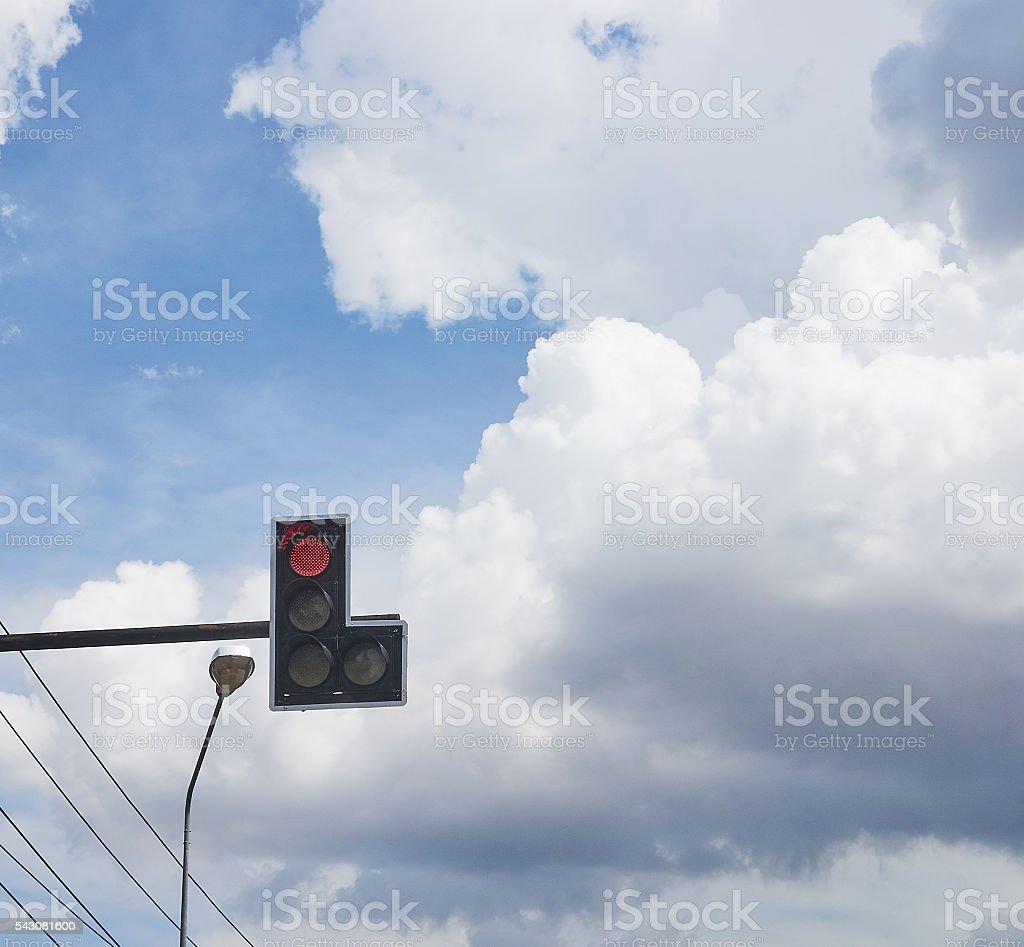 Red traffic light near street lamp. stock photo