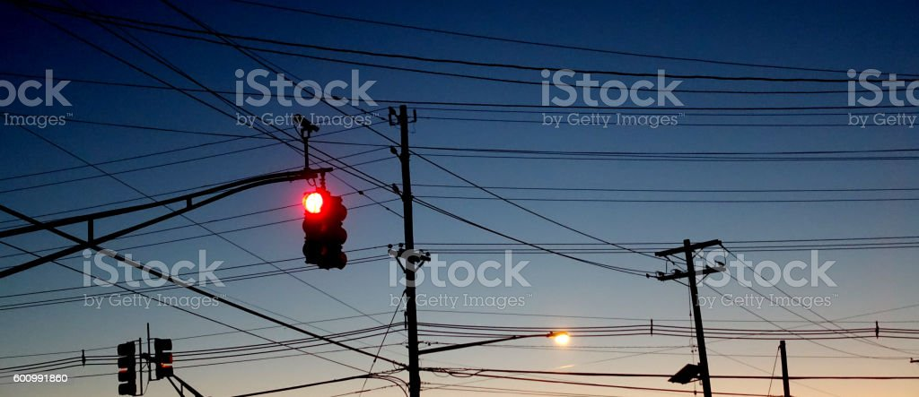 Red Traffic Light with Many Wires in Background stock photo