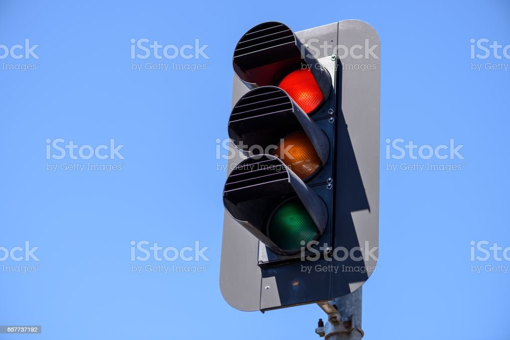 Red traffic lights in the blue sky background stock photo