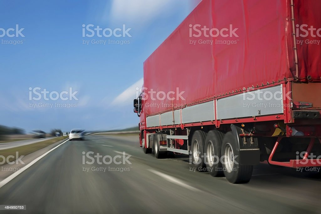 red trailer on the highway royalty-free stock photo