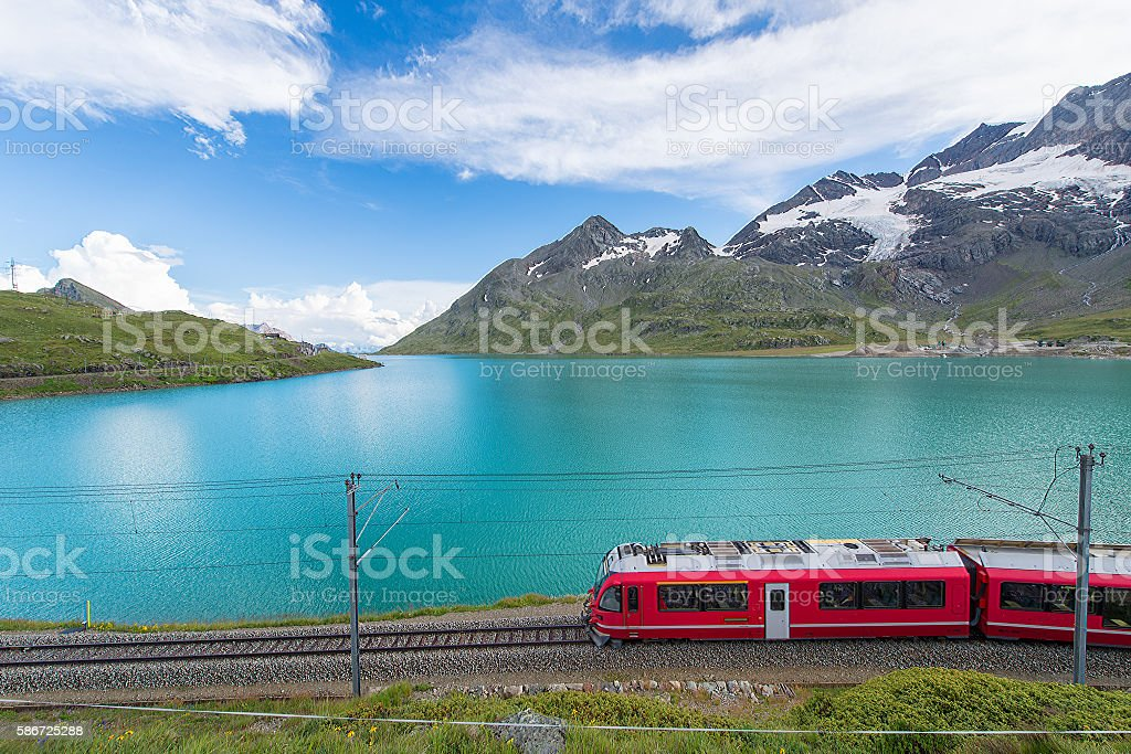 Red train in the high mountains of the Swiss Alps stock photo