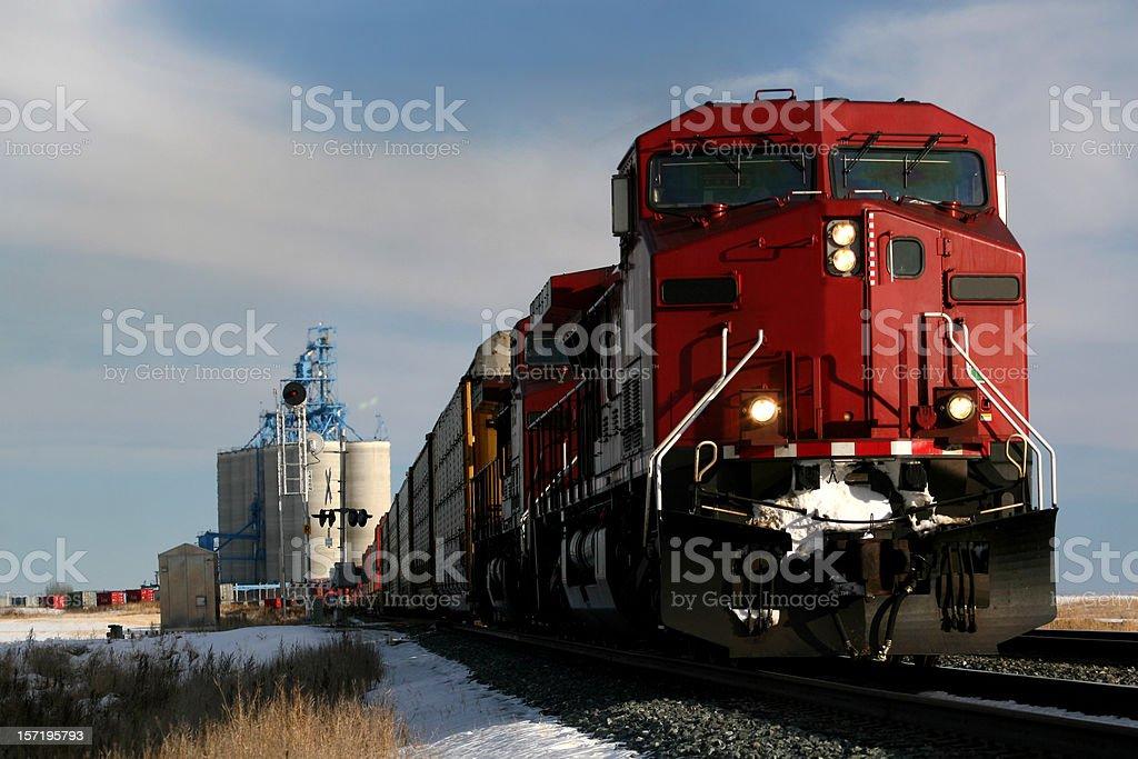Red train on tracks in Alberta, Canada stock photo