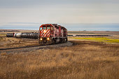 Red Train Zigzagging Across Prairie Landscape