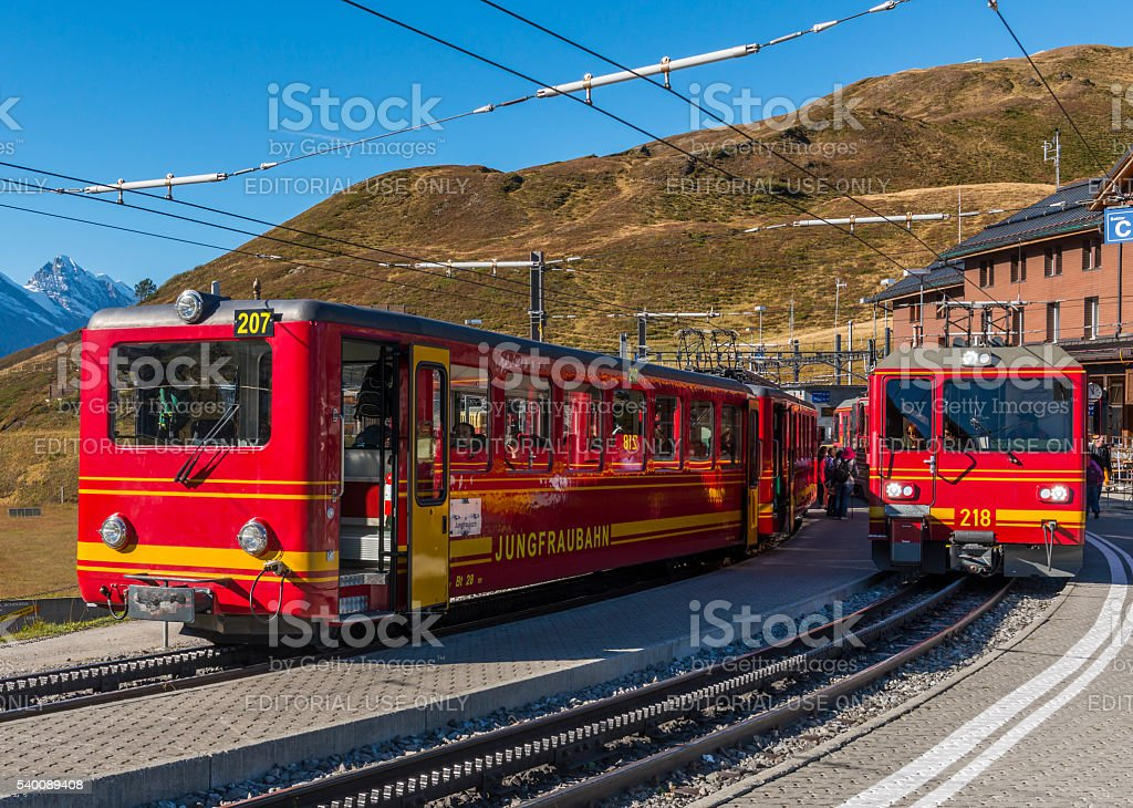 Red Trains of Jungfraubahn stock photo