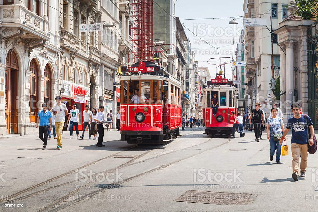 Red tram goes on Istiklal to Taksim, Istanul stock photo