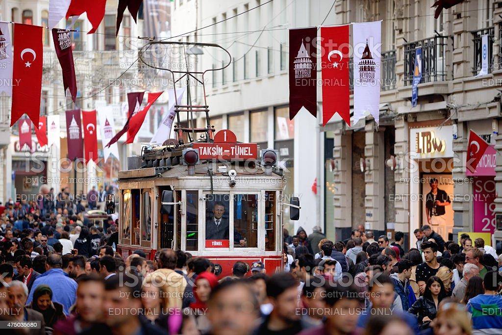 Red Tram on Istiklal street, Istanbul, Turkey. stock photo