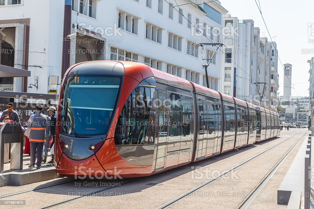 Red tram on the stop. stock photo