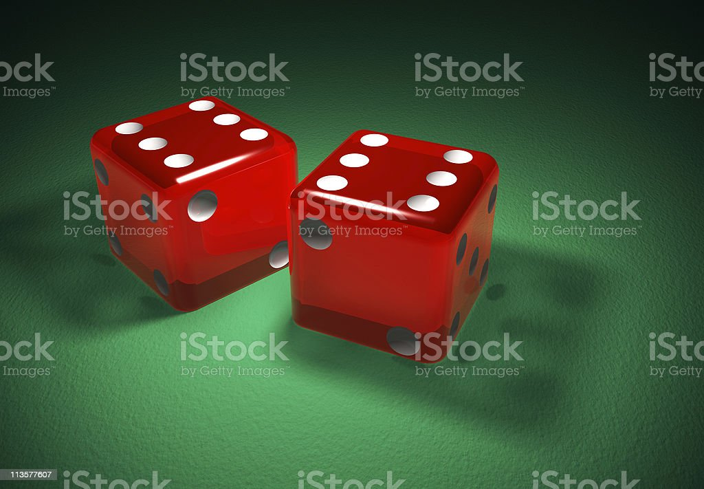 Red transparent dice on green surface stock photo