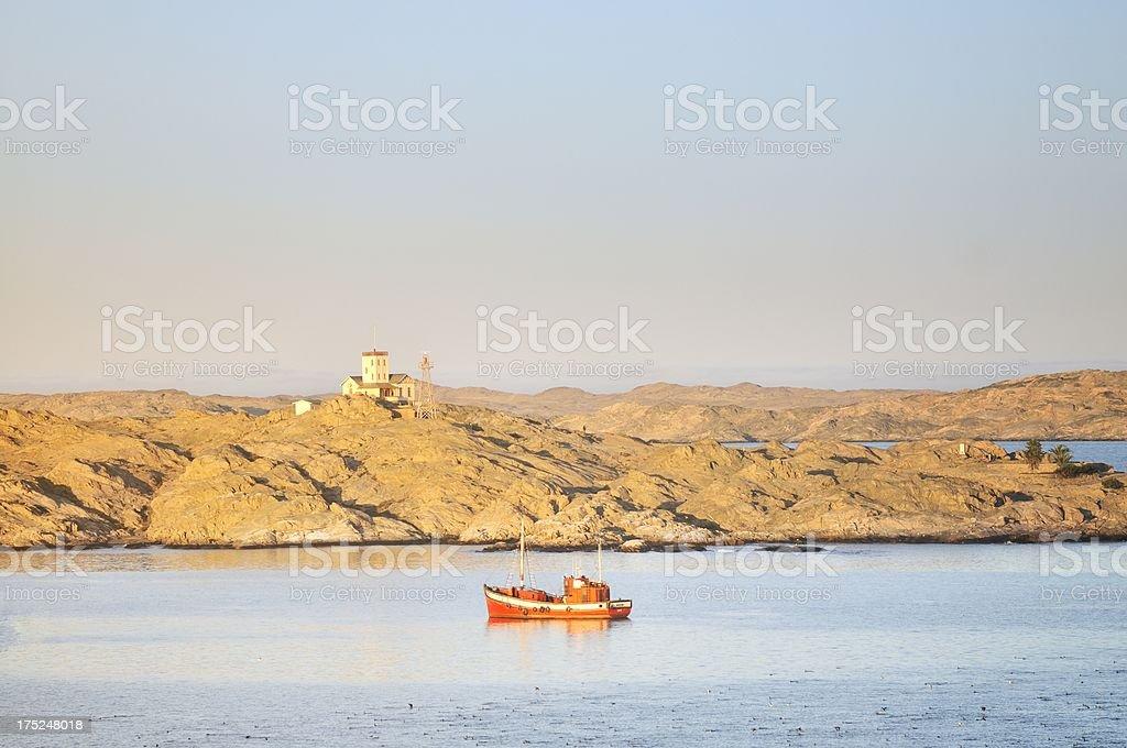 Red Trawler Off Shark Island stock photo