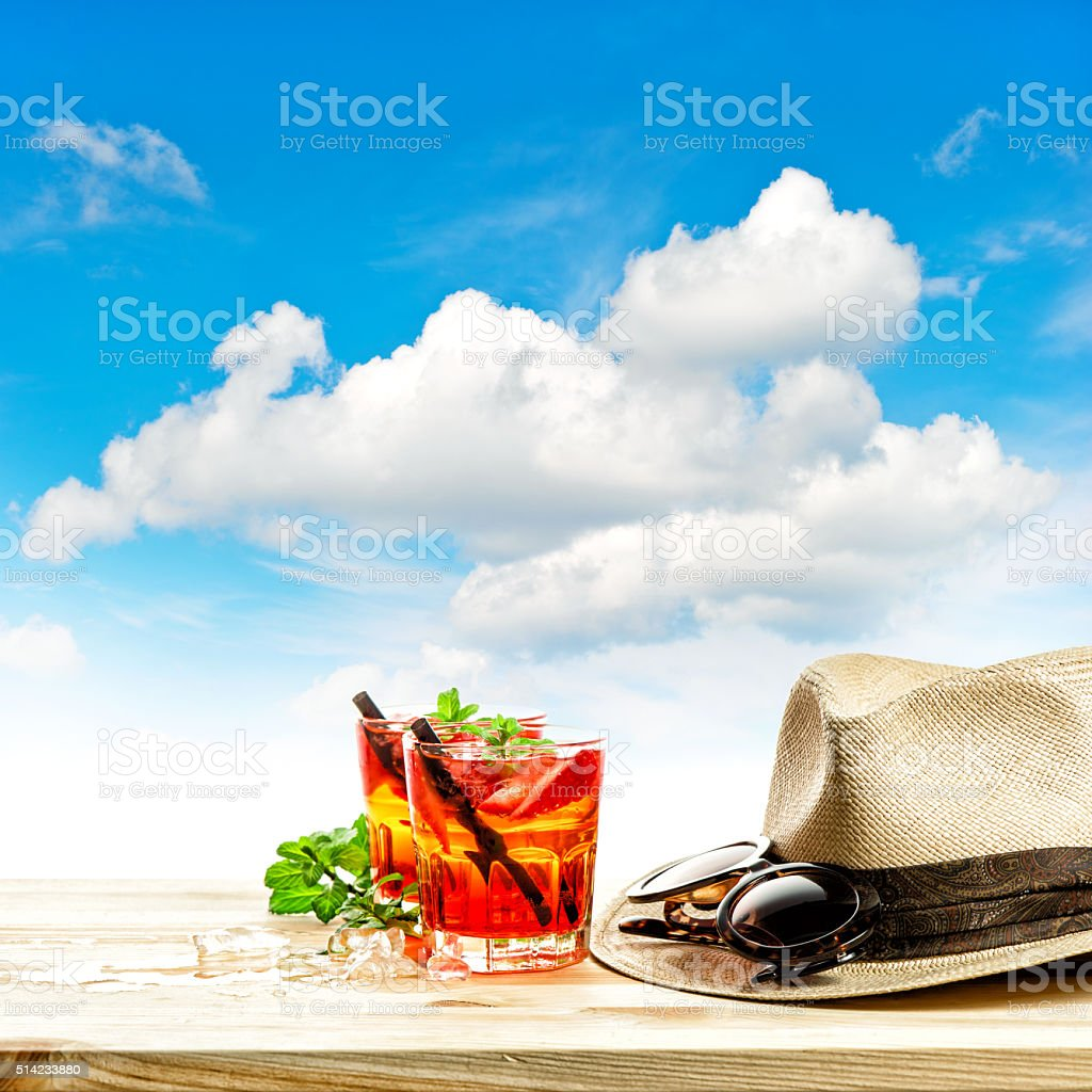 Red tropical drink and green mint leaves. Summer holidays stock photo