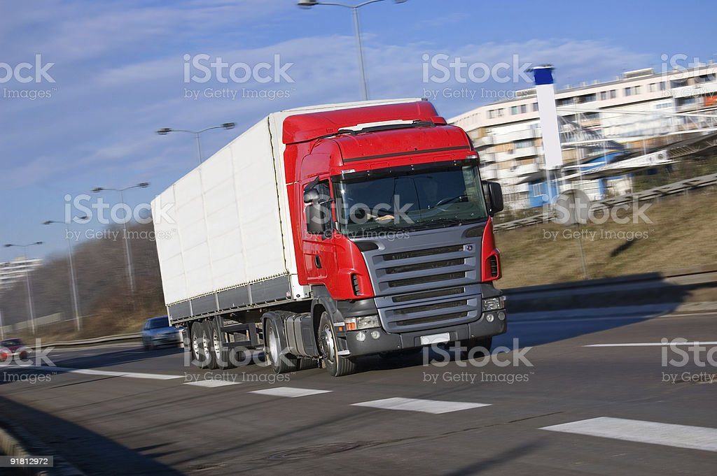Red Truck Driving Fast royalty-free stock photo