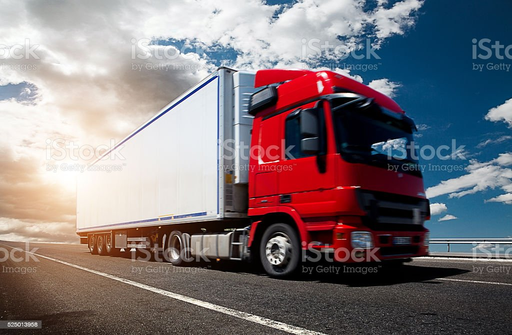 Red truck driving on highway stock photo
