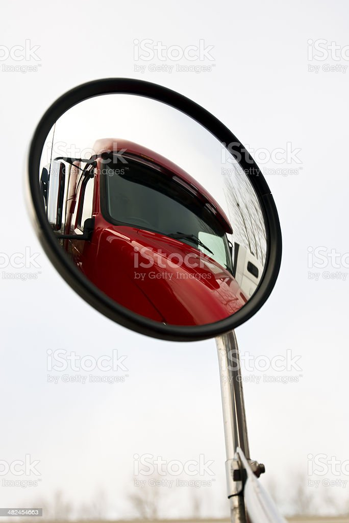 Red truck in mirror stock photo