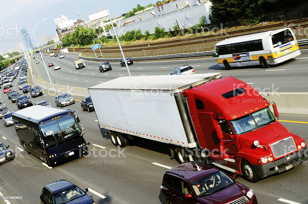 Red truck in the highway stock photo