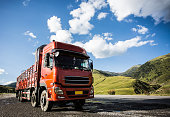 red truck on blurry asphalt road