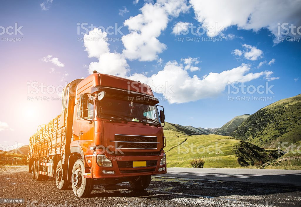 red truck on blurry asphalt road stock photo