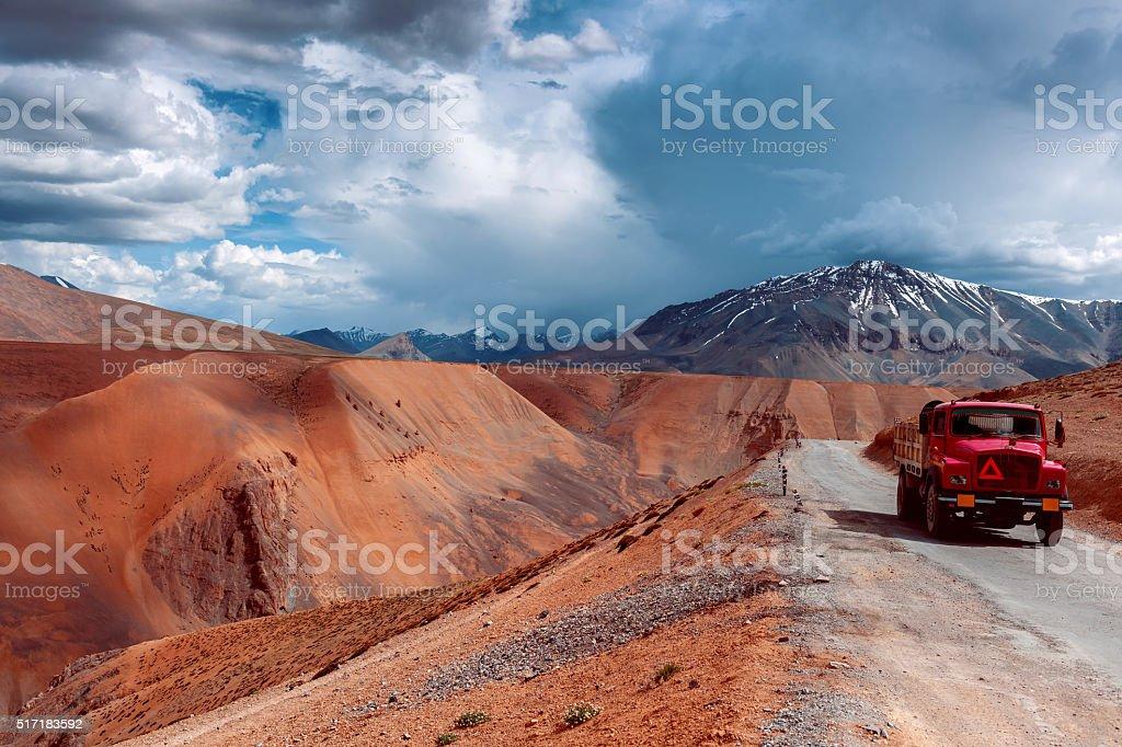 Red  truck on Cloudy Day Plateau Mora,Ladakh,Himalaya, India stock photo