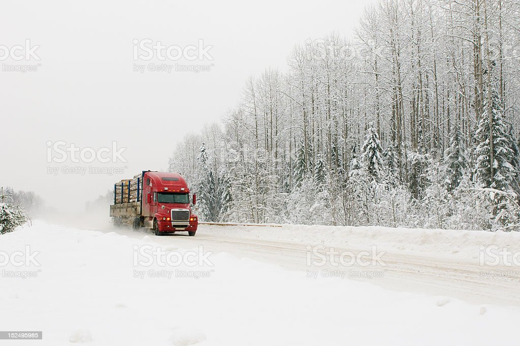 red truck on winter road stock photo