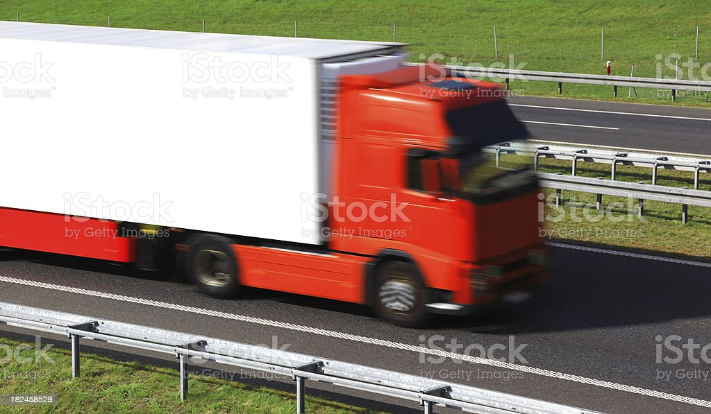 Red Truck Speeding On Highway royalty-free stock photo