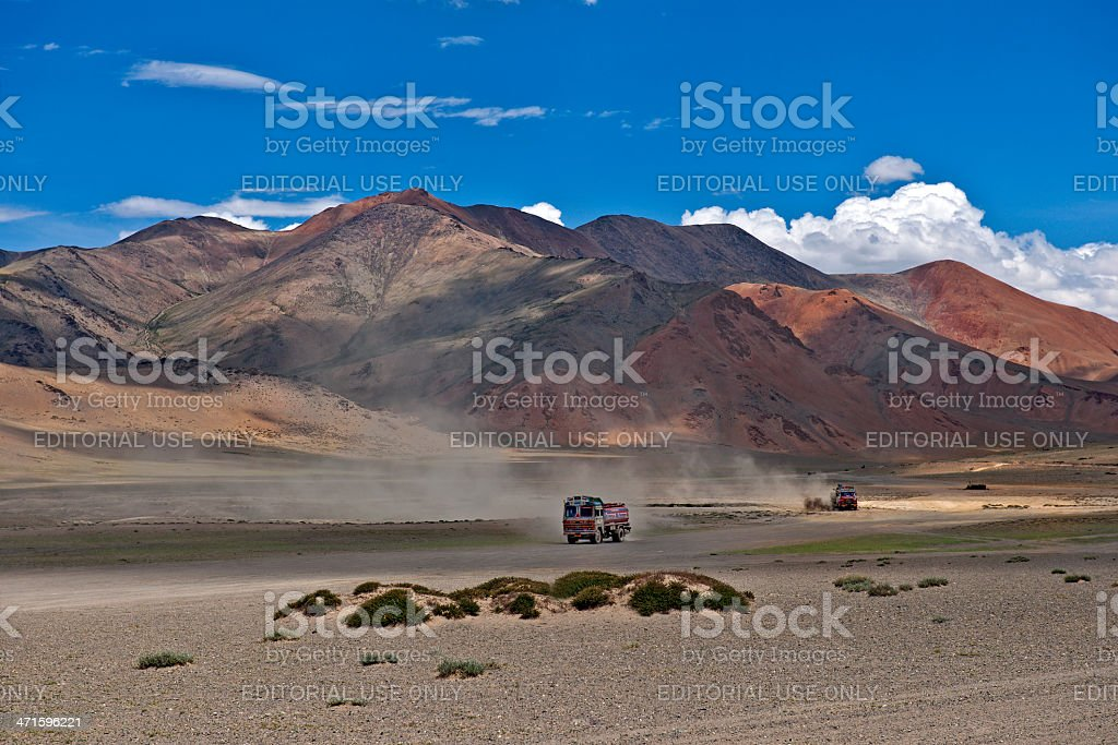 Red Trucks Delivering Fuel Leh-Manali Highway Plateau Mora India stock photo