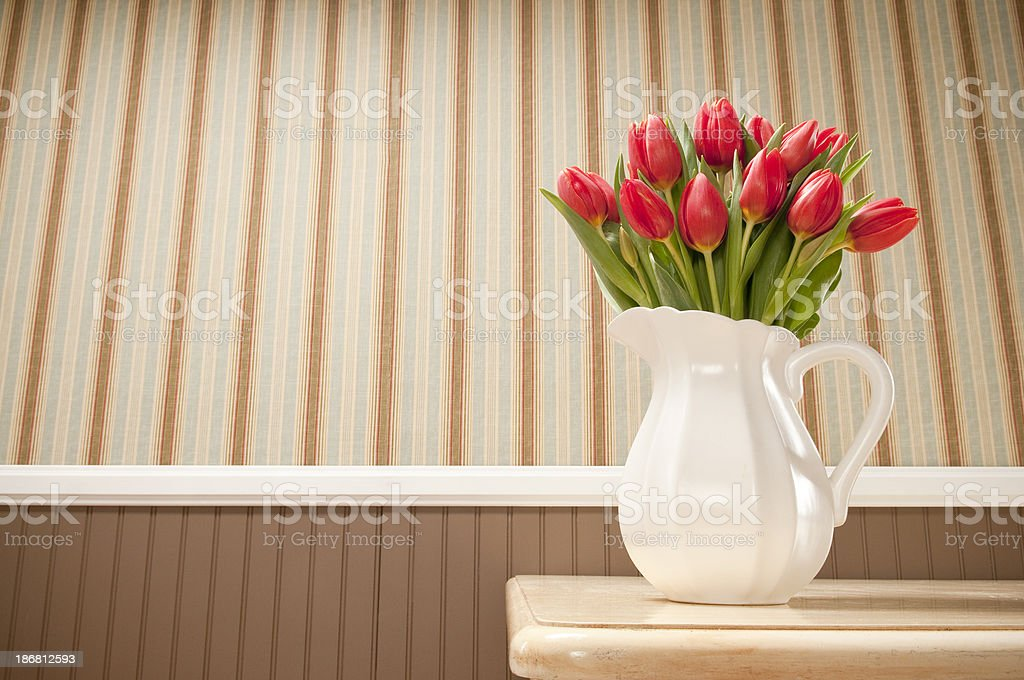Red Tulips On Dining Table royalty-free stock photo