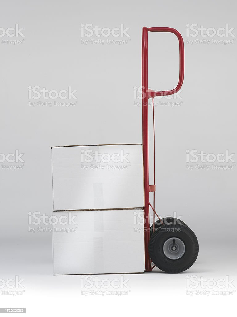 red two wheel dolly with  corrugated white boxes stock photo