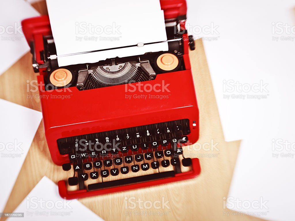Red typewriter and papers on floor royalty-free stock photo