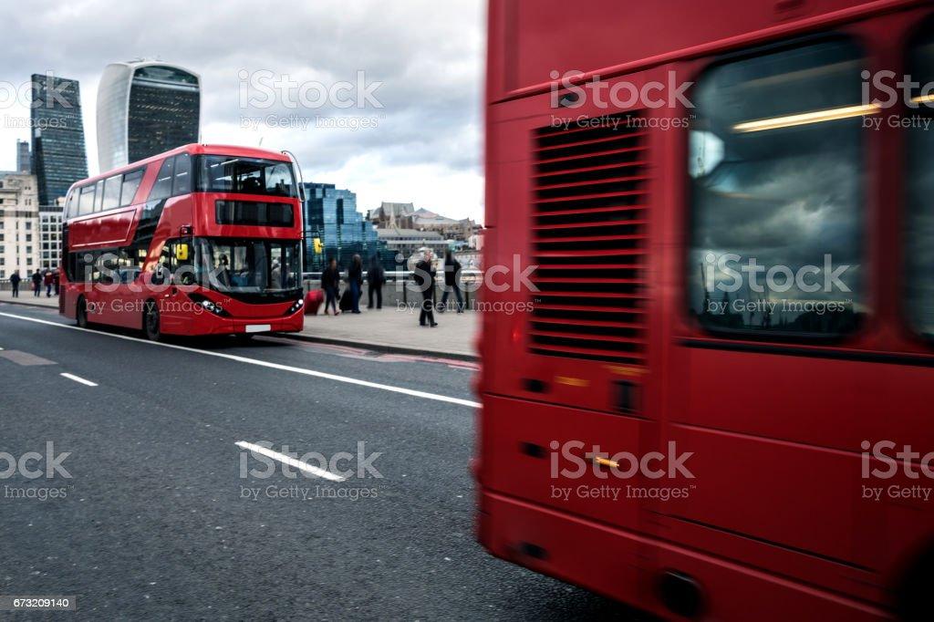 Red typical London bus on London Bridge stock photo