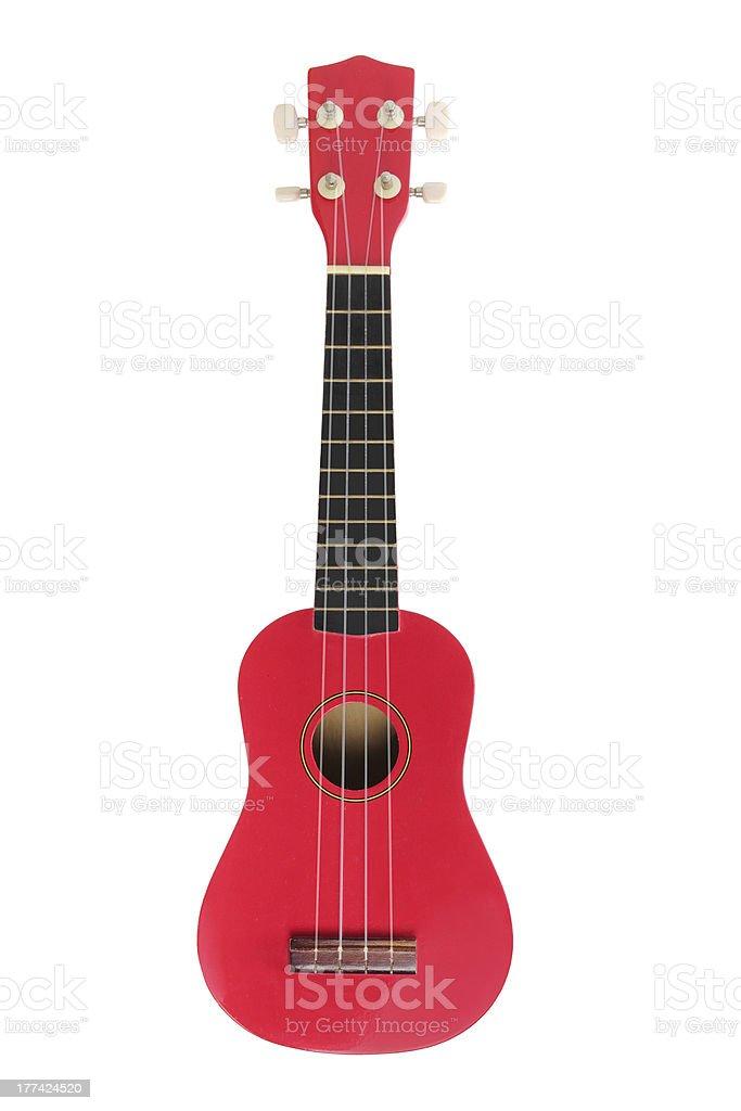 A red ukulele on a white background stock photo