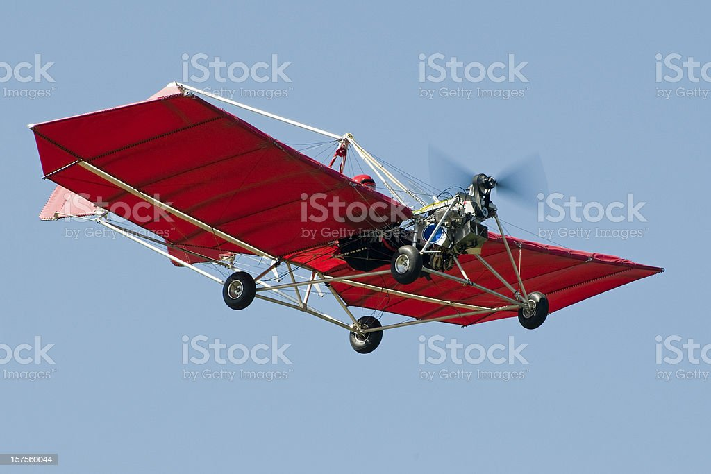 red ultralight aircraft Snedden M7 flying in clear lue sky stock photo