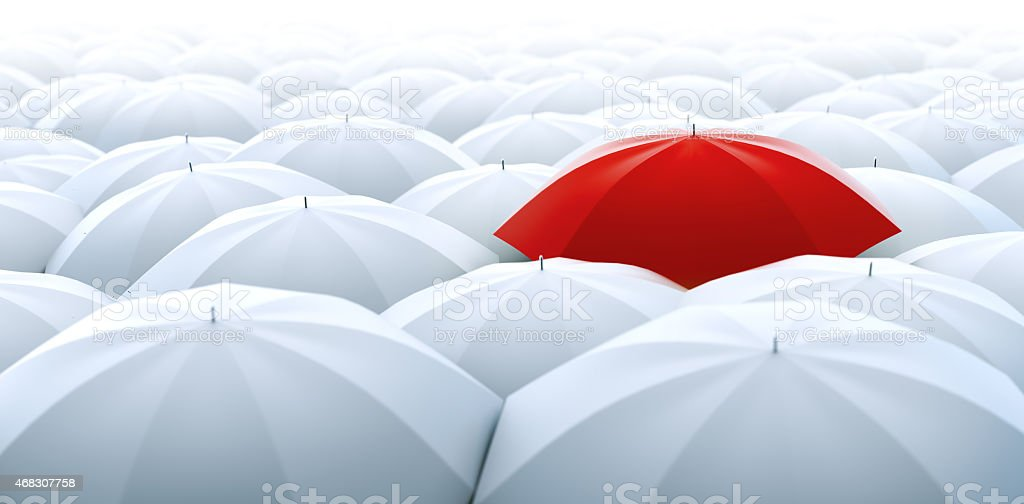 Red umbrella. Different, leader, unique, boss, individuality, original, special concept stock photo