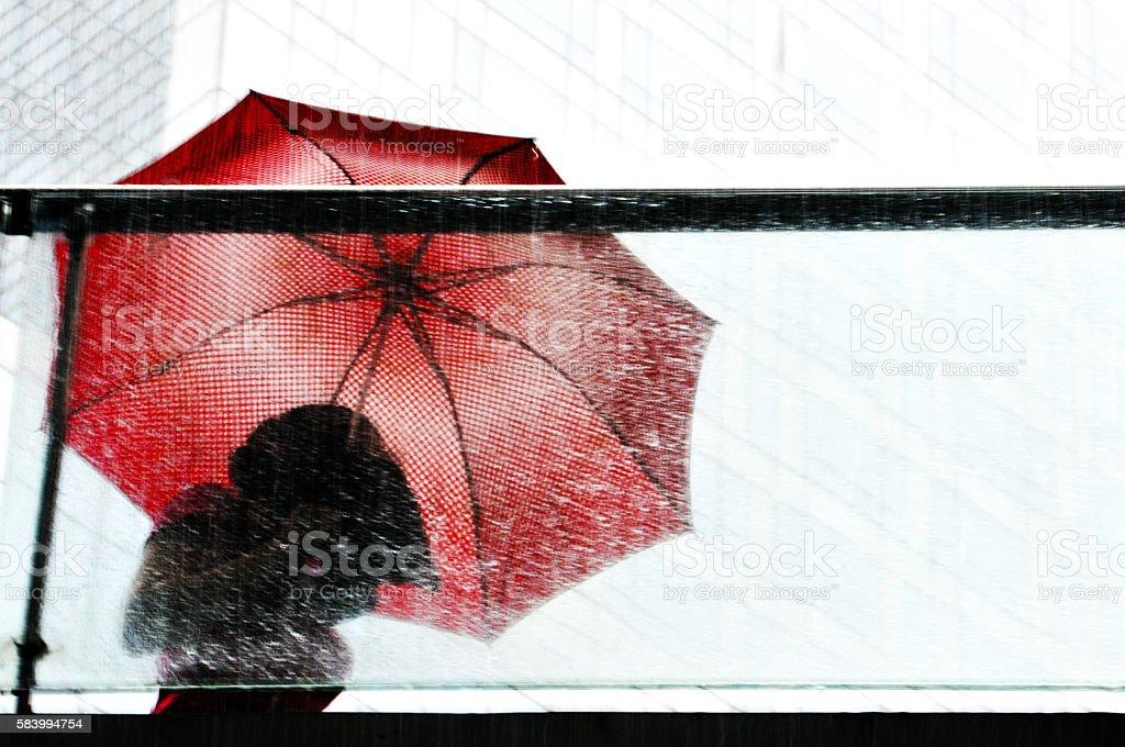 Red Umbrella In A Rainstorm stock photo