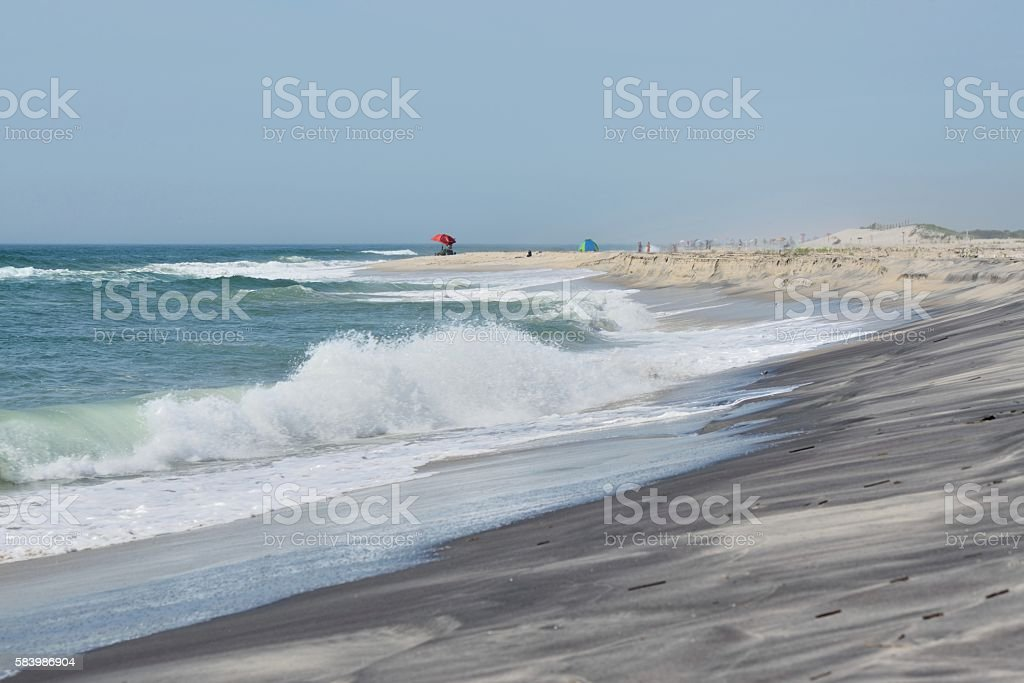 Red Umbrella on Assateague Island Beach stock photo